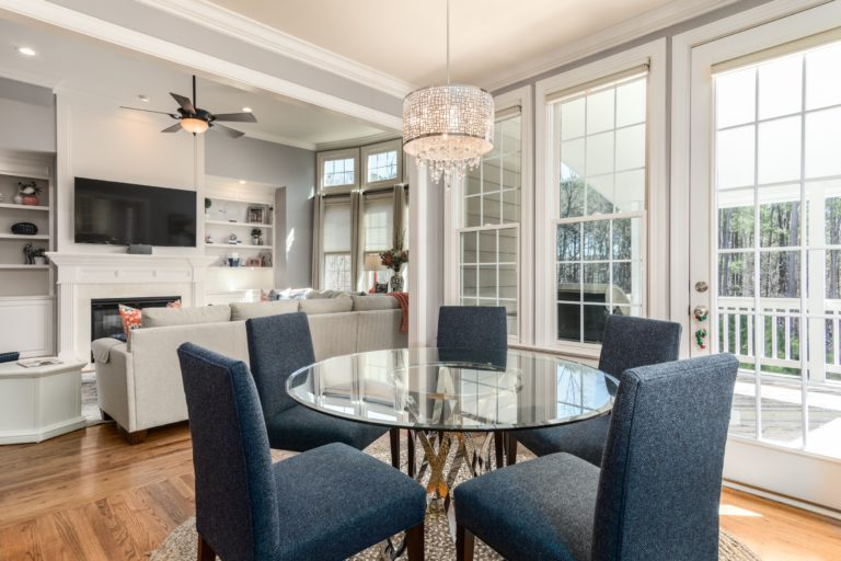 round clear glass-top table and five gray chairs dining se